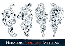 Set of heraldic flourish patterns Royalty Free Stock Photos