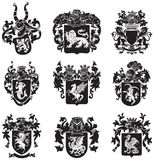 Set of heraldic silhouettes No4. Vector image of black medieval heraldic silhouettes, executed in woodcut style, isolated on white background. No blends Royalty Free Stock Photo