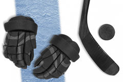 A set of hockey accessories on the blue line. Gloves, stick and puck on the ice hockey rink. Concept, hockey, line Royalty Free Stock Image