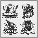 Set of hockey badges, labels and design elements. Sport club emblems with grizzly bear, panther, coyote and eagle. vector illustration