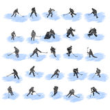 Set of hockey player grunge silhouettes Stock Photos