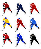 Set hockey players in the national jerseys Stock Photography