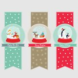 Set of holiday banners and bookmarks with snow balls and cute animals inside. Stock Image