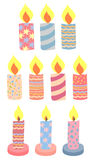 A set of holiday candles. Isolated festive burning candles with vivid pictures Royalty Free Stock Image