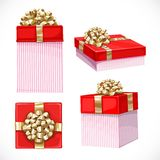 Set of holiday gifts in red boxes with gold bow Stock Photography
