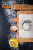 Set for home baking on a black background with flour. Rolling pi Stock Image
