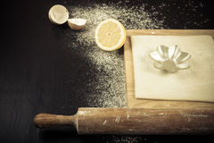 Set for home baking on a black background with flour. Rolling pi Royalty Free Stock Photos