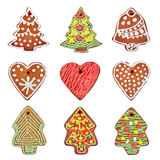 Set of homemade gingerbread cookies isolated over white. Heart, Christmas tree, bell. Stock Photography