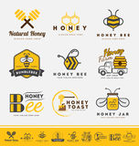 Set of honey bee logo and labels for honey products. Royalty Free Stock Photo