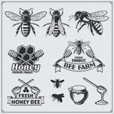 Set of honey labels, badges and design elements. Honeycombs, bees, honey emblems. royalty free illustration