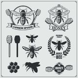 Set of honey labels, badges and design elements. Honeycombs, bees, honey emblems. Vector stock illustration