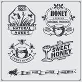 Set of honey labels, badges and design elements. Honeycombs, bees, honey emblems. vector illustration