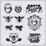 Set of honey labels, badges and design elements. Honeycombs, bees, honey emblems. Vector vector illustration
