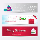 Set of horizontal banners. Holiday Sale background with stylized word Sale, of christmas symbols on a gift box Stock Photos