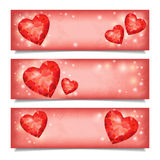 Set of horizontal  banners with red ruby heart shapes. Set of horizontal  banners with red ruby hearts and  lights, isolated on white background. Vector Stock Photo