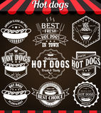 Set of hot dogs retro vintage labels, badges and logos on blackboard. Royalty Free Stock Images