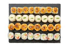 Set of hot lava maki japanese sushi rolls isolated on shale food board on white background. Set of hot lava maki japanese sushi rolls isolated on shale food royalty free stock image