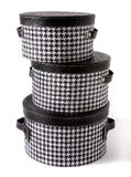 Set of houndstooth check and black leather bandboxes. Isolated on white background Royalty Free Stock Photo