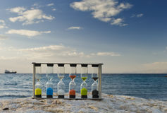 Set of hourglasses on the beach Royalty Free Stock Image