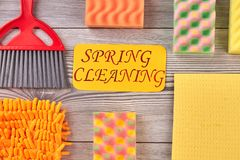 Set of house cleaning items. Kitchen sponges, napkins and brushes on wooden background. Big spring cleaning stock image