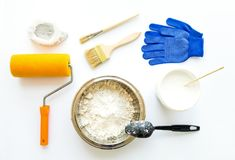 Set of house repair constructing and painting equipment on white background. Flat lay. Set of house repair constructing and painting equipment on white stock photo