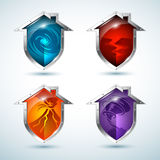 Set of house-shaped shield icons that illustrate natural disasters Stock Photography