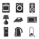 Set of household appliances silhouette icons. With a washing machine stove fridge speaker iron microwave lamp television kettle Royalty Free Stock Images