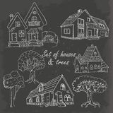Set of houses and trees on black. Vector illustration Stock Image