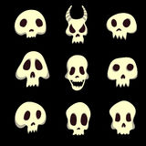 Set of human and animal skulls. Vector illustration, isolated on black. Royalty Free Stock Images