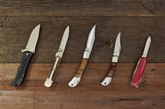 Set of hunting knives on wooden background Stock Photo