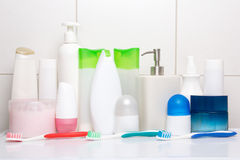 Set of hygiene supplies over tiled wall Stock Image