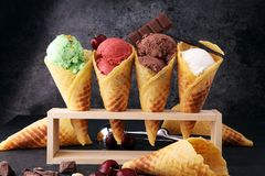 Set of ice cream scoops of different colors and flavours with be. Rries, nuts and fruits Stock Photos