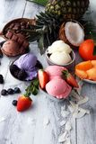 Set of ice cream scoops of different colors and flavours with be Stock Photos