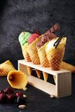Set of ice cream scoops of different colors and flavours with be Stock Images