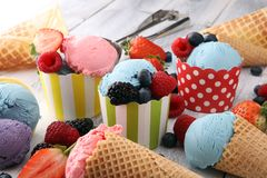 Set of ice cream scoops of different colors and flavours with bl stock photo