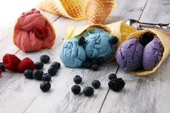 Set of ice cream scoops of different colors and flavours with bl royalty free stock photography