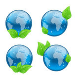 Set icon earth with green leaves isolated on white. Illustration set icon earth with green leaves isolated on white background, environment symbols - vector Royalty Free Stock Photography