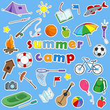 Set of icon patches on the subject of vacation and summer camps on a blue background Stock Images