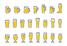 Set icons of beer with foam in mugs and glasses Royalty Free Stock Photos