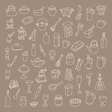 Set of 60 icons of different types of cookware. On brown background Royalty Free Illustration
