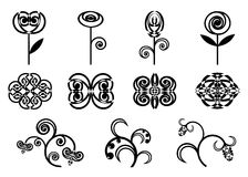 Set of icons flowers. A set of icons, black flowers with patterns on a white background Royalty Free Stock Image
