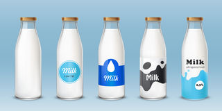 Set of icons glass bottles with a milk Royalty Free Stock Photo