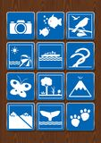 Set icons of photography, aquarium, bird watching, beach, navigable river, serpentarium, butterfly garden, forest, volcano, whale. Watching, zoo. Icons in blue Royalty Free Stock Photos