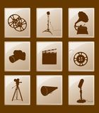Set of icons with retro silhouettes. Set of icons with silhouettes; gramophone and reflector, film and camera and microphone and megaphone Stock Image