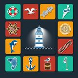 Marine set of objects-01. Set of icons on a sea theme. Steering wheel, compass, floats, anchor, circle, dolphin, lantern, against a dark background lighthouse in Stock Photography