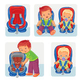 Set icons of small children in car seats Royalty Free Stock Images
