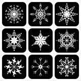 Set of icons with snowflakes. On black Stock Images
