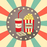 Set of icons in the style an old movie. Tickets, popcorn, a drink with straw on background rays. Stock Images