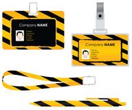Set of identity cards. Illustrated set of identity cards and and pen with yellow and black stripes and copy space; white studio background Royalty Free Stock Photos