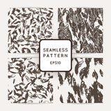 Set of ik feather seamless patterns. Hand drawn doodle vector backgrounds. Stock Photos